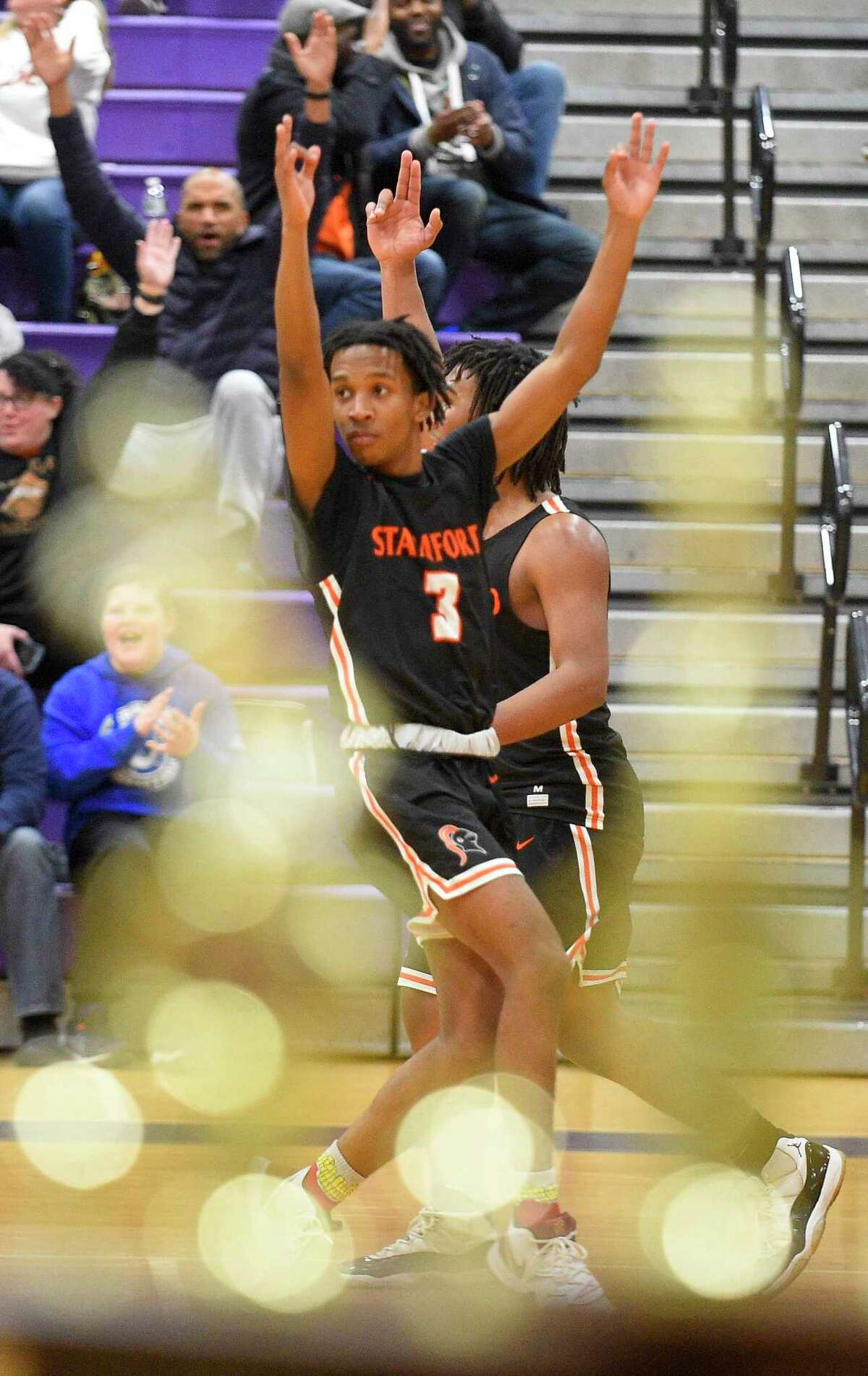 Stamford's Damani Taylor (3) celebrates his fade away three pointer in the third quarter against Westhill in a boys basketball game of the MLK Classic Basketball Tournament at Westhill High School in Stamford, Conn. on Feb. 1, 2020. Taylor shot, the turning point and go ahead basket helped Stamford defeat Westhill 57-51.