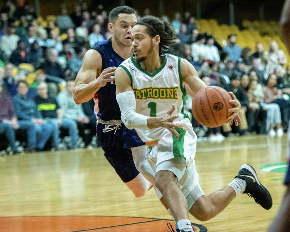 Albany Patroons guard Robert Shaw dribbles up court in front of Tri-State Admirals guard Jesse Steele during The Basketball League season opener at the Washington Avenue Armory in Albany NY on Saturday, Feb. 1, 2019 (Jim Franco/Special to the Times Union.)