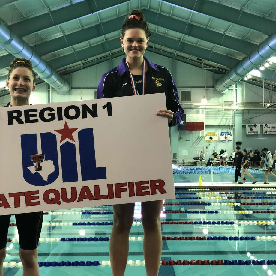 Midland High sophomore PJ Day stands atop the podium after winning the girls 100-yard breaststroke at the Region I-6A Swimming & Diving Championships, Feb. 1 in Lubbock. Day qualified for the UIL state meet. Photo: Courtesy Photo