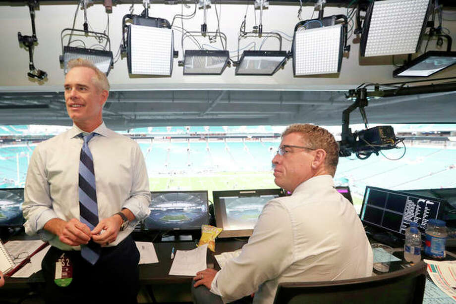 Fox Sports play-by-play announcer Joe Buck, left, and analyst Troy Aikman, right, work in the broadcast booth before a preseason game between the Miami Dolphins and Jacksonville Jaguars in Miami Gardens, Fla. Photo: AP Photo