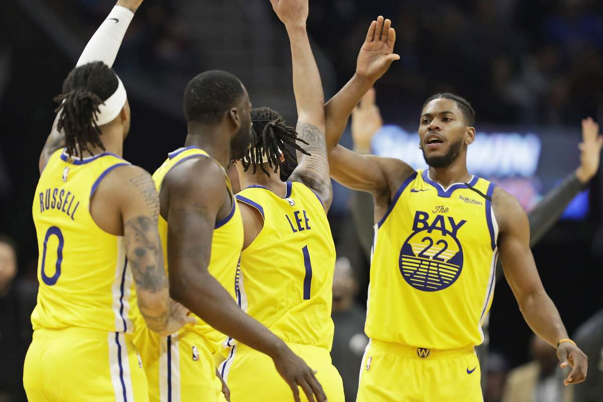 Golden State Warriors' Glenn Robinson III (22) is congratulated by teammates in the second half of an NBA basketball game against the Cleveland Cavaliers, Saturday, Feb. 1, 2020, in Cleveland. (AP Photo/Tony Dejak)