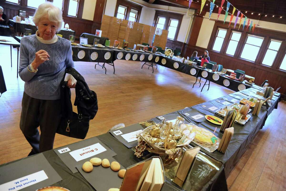 Carol Nichols of Fairfield looks over the entries at the Pequot Library's first-ever Edible Book Festival on Saturday, Feb. 1, 2020, in Fairfield, Conn.