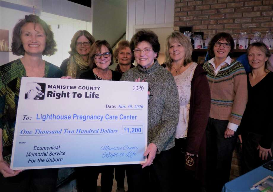 """Cathy Johnson (far left) and LPCC board members receive a check from local Right to Life representatives during """"Michigan's Biggest Baby Shower,"""" a donation drive for the pregnancy care center. (Scott Fraley/News Advocate)"""