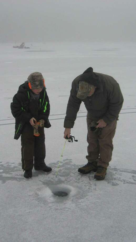 Gabriel Cavanaugh and his dad, Tim, ice fish at the DEEP's winter festival on Feb. 1. Photo: John Torsiello / For Hearst Connecticut Media
