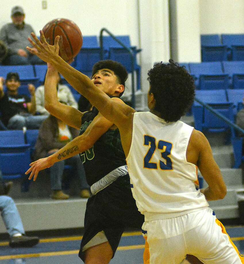 Floydada's Marcus Perez puts up the shot attempt while being defended by Hale Center's David Espinosa during their District 4-2A boys basketball game on Friday, Jan. 31, 2020 at Hale Center High School. Photo: Nathan Giese/Planview Herald