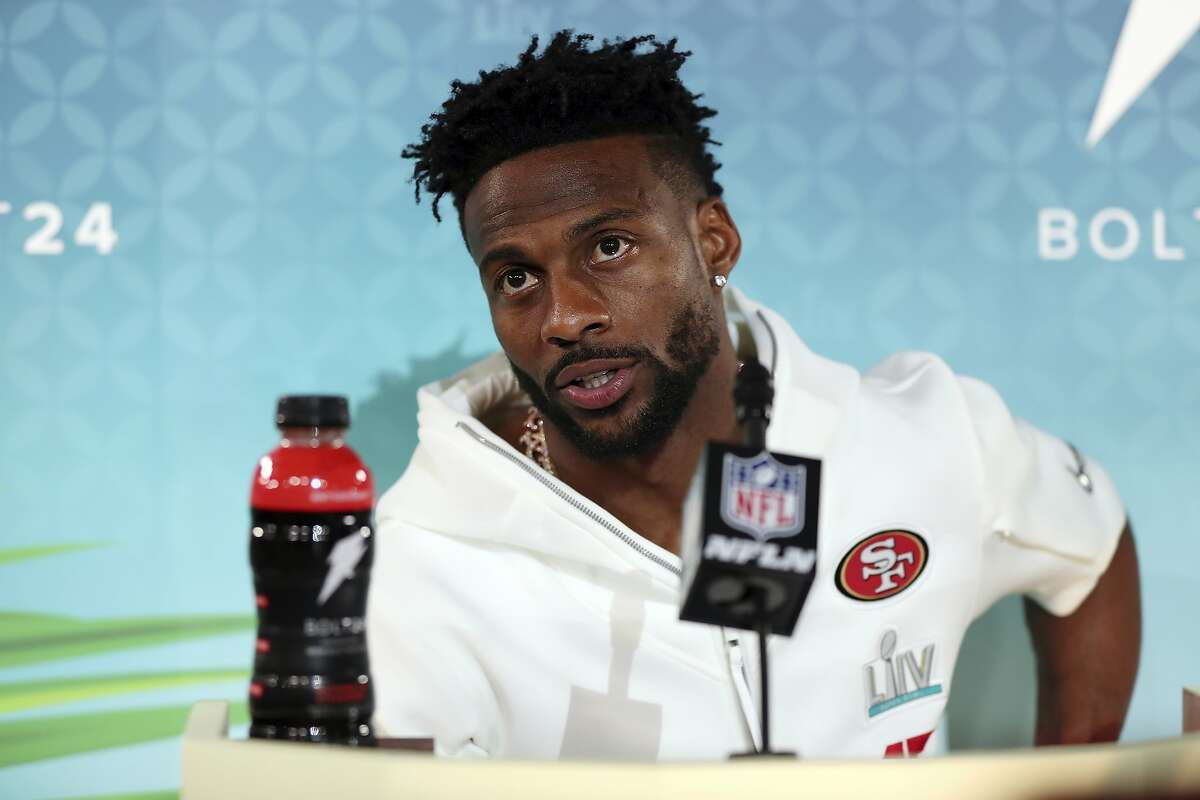 San Francisco 49ers wide receiver Emmanuel Sanders speaks to the media during Opening Night for the NFL Super Bowl 54 football game, Monday, Jan. 27, 2020, in Miami. (AP Photo/Steve Luciano)