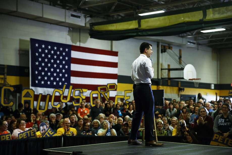 Democratic presidential candidate Pete Buttigieg addresses a campaign rally at a school in Coralville, Iowa. Polls show a tight and unpredictable race to win Monday's caucuses in Iowa. Photo: Matt Rourke / Associated Press