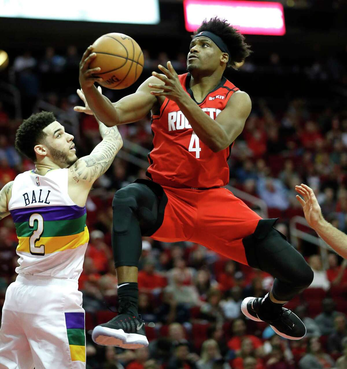Houston Rockets forward Danuel House Jr. (4) goes up for the basket against New Orleans Pelicans guard Lonzo Ball (2) during the first half of an NBA basketball game at Toyota Center in Houston, Sunday, Feb. 2, 2020.