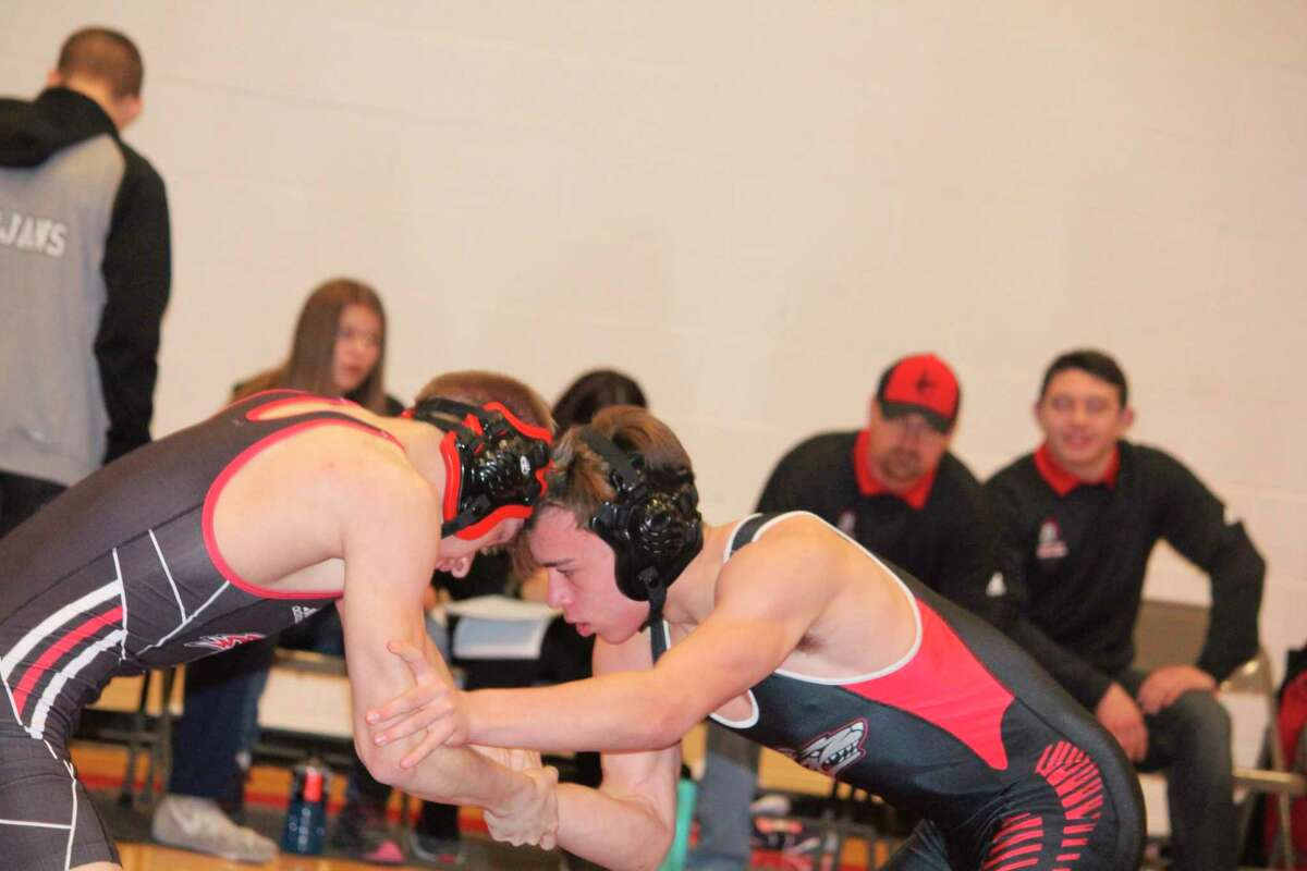 Reed City's Aaron Boucher (right) works against Lake City's Aaron Shivlie during Saturday's RC team Invitational. (Pioneer photo/John Raffel)