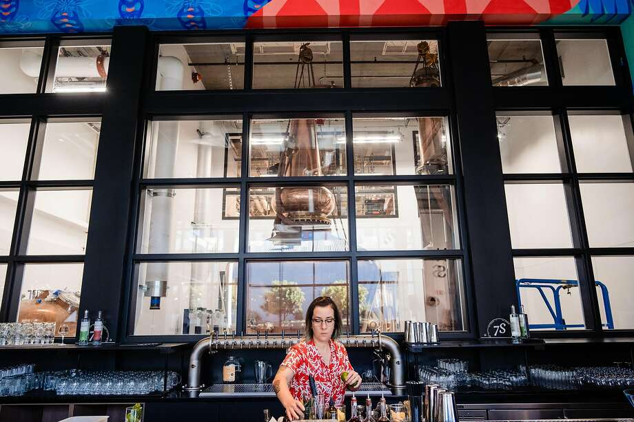 Bartender Jess Rothenburger prepares the bar at the new Seven Stills location in Mission Bay. Photo: Nick Otto / Special To The Chronicle