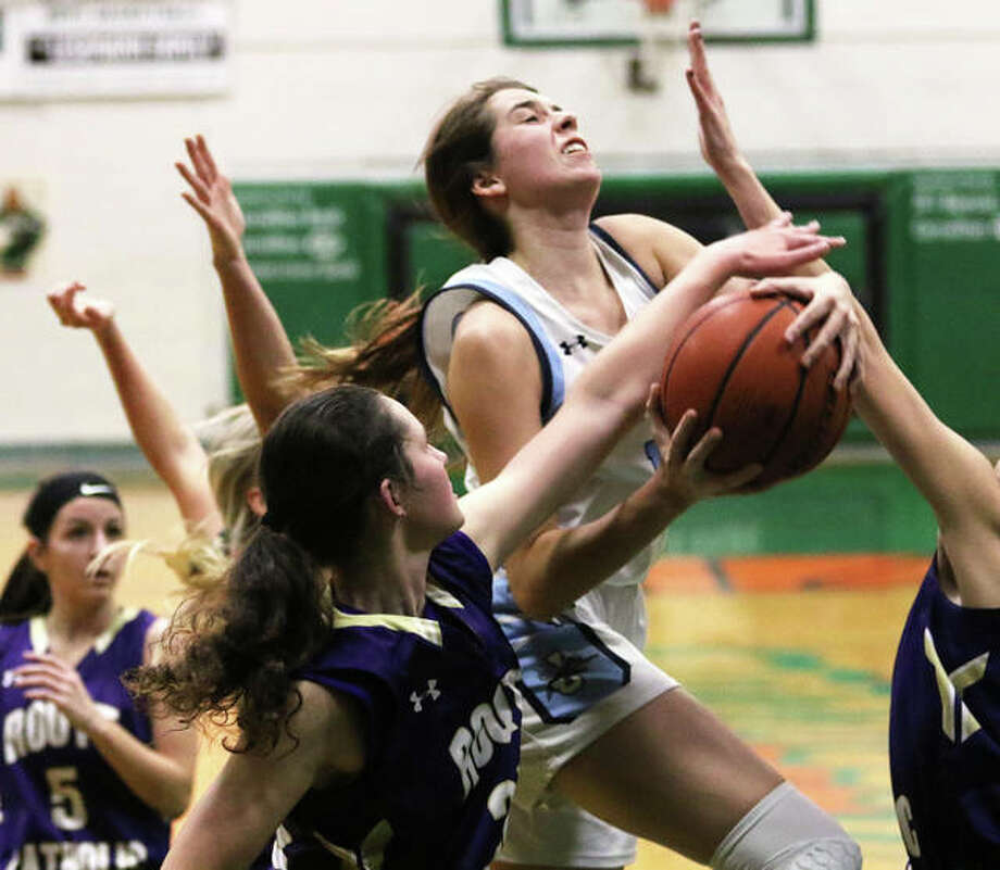 Jersey's Abby Manns (middle) puts up a shot in traffic in the lane against Jacksonville Routt on Saturday night in the championship game of the Carrollton Tournament. Photo: Greg Shashack / The Telegraph
