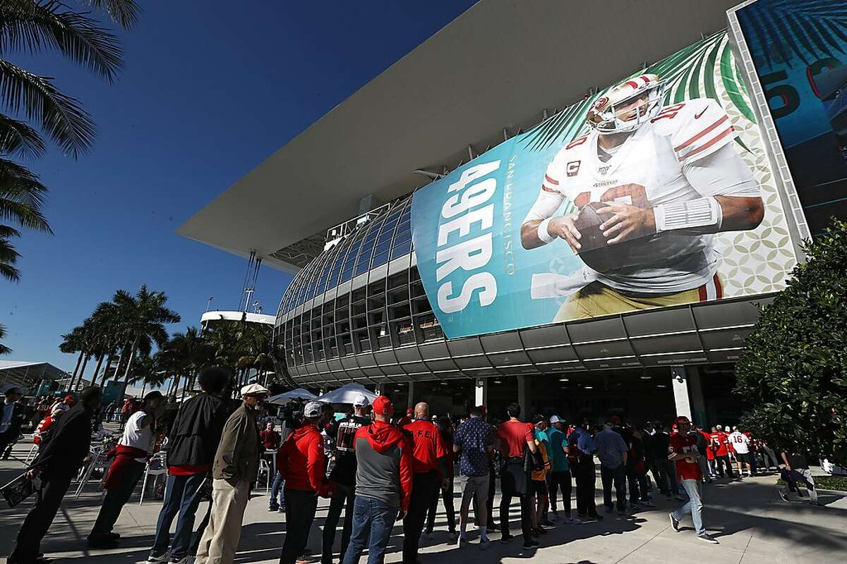 MIAMI, FLORIDA - FEBRUARY 02: Fans queue to enter to Hard Rock Stadium for Super Bowl LIV on February 02, 2020 in Miami, Florida. (Photo by Ronald Martinez/Getty Images)