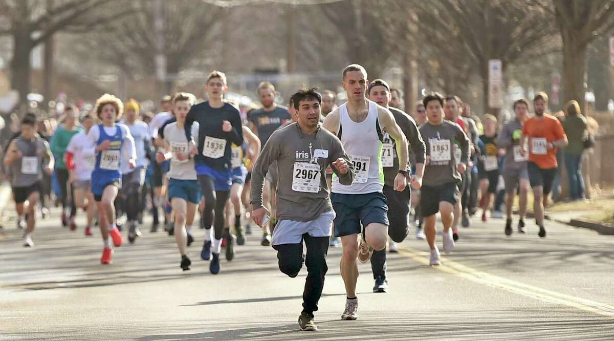 New Haven, Connecticut - February 02, 2020: Runners on Mitchell Drive at the start of the Run for the Refugees 5K road race and walk Sunday morning in New Haven that benefits IRIS (Integrated Refugee and Immigrant Services), starting and ending at Wilbur Cross High School.