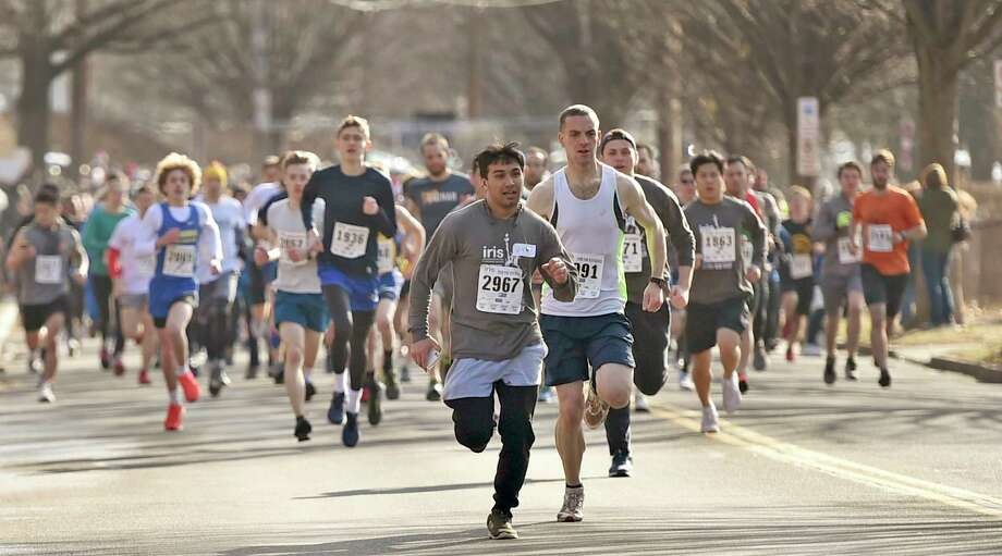 New Haven, Connecticut - February 02, 2020:  Runners on Mitchell Drive at the start of the Run for the Refugees 5K road race and walk Sunday morning in New Haven that  benefits IRIS (Integrated Refugee and Immigrant Services), starting and ending at Wilbur Cross High School. Photo: Peter Hvizdak, Hearst Connecticut Media / New Haven Register