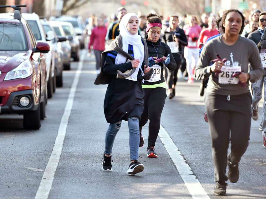 New Haven, Connecticut - February 02, 2020: Runners come down Orange Street during the Run for the Refugees 5K road race and walk Sunday morning in New Haven that benefits IRIS (Integrated Refugee and Immigrant Services), starting and ending at Wilbur Cross High School.