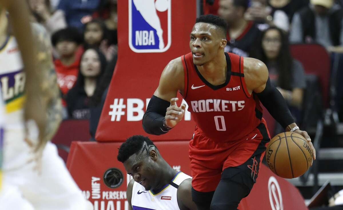 Houston Rockets guard Russell Westbrook (0) recovers a rebound against New Orleans Pelicans forward Zion Williamson (1) during the first half of an NBA basketball game at Toyota Center in Houston, Sunday, Feb. 2, 2020.