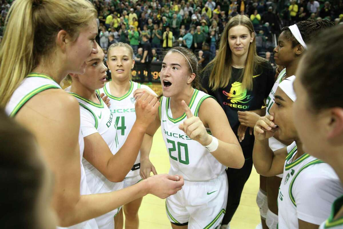 Oregon's Sabrina Ionescu, center, and teammates celebrate after defeating Stanford 87-55 during an NCAA college basketball game in Eugene, Ore., Thursday, Jan. 16, 2020. (AP Photo/Chris Pietsch)