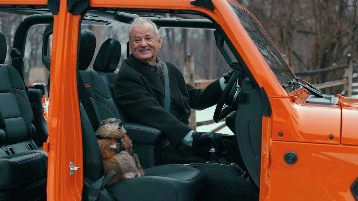 This undated image provided by Jeep shows Bill Murray reprises his role as Phil Connors from the 1993 film a€œGroundhog Day,a€ in a scene from the company's 2020 Super Bowl NFL football spot. (Jeep via AP)
