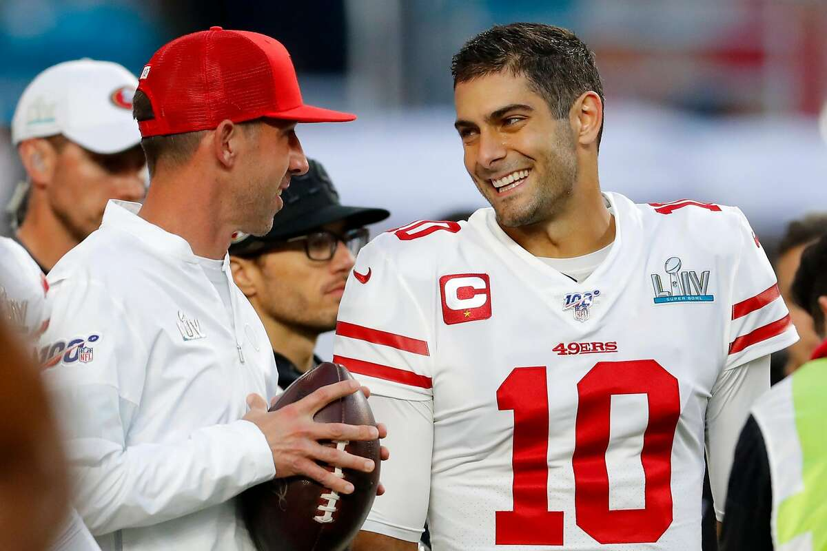 Head coach Kyle Shanahan of the San Francisco 49ers talks with Jimmy Garoppolo #10 prior to Super Bowl LIV against the Kansas City Chiefs at Hard Rock Stadium on February 02, 2020 in Miami, Florida. (Photo by Kevin C. Cox/Getty Images)