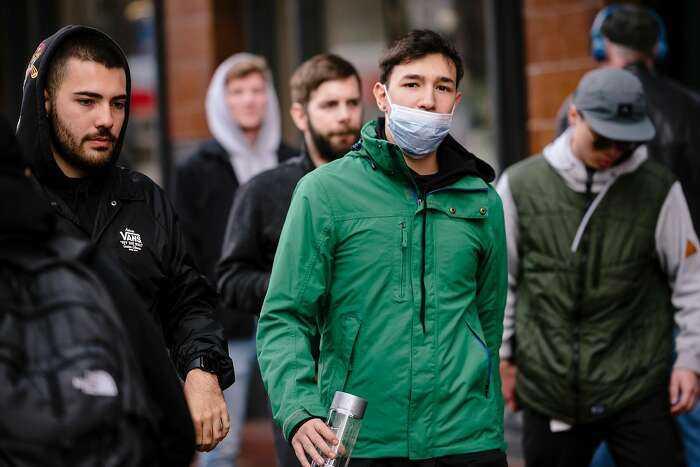 Brun Garcia, visiting from Brazil, wears a filter mask because he is sick and also because of fears over the coronavirus outbreak, in San Francisco, Calif, on Tuesday, January 28, 2020.