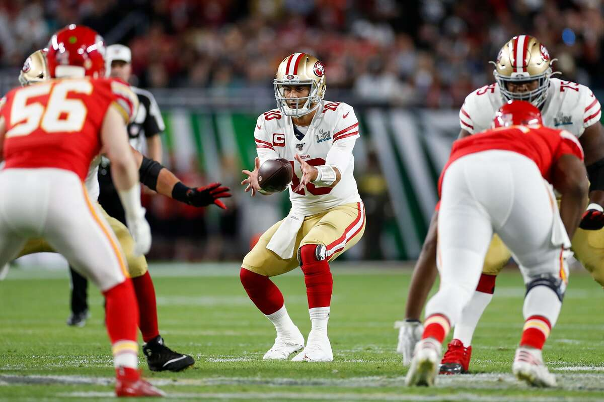 San Francisco 49ers' Jimmy Garoppolo takes a snap in the first quarter during Super Bowl LIV between the San Francisco 49ers and the Kansas City Chiefs at Hard Rock Stadium on Sunday, Feb. 2, 2020 in Miami Gardens, Fla.