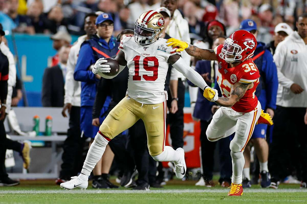 Kansas City Chiefs' Tyrann Mathieu pushes San Francisco 49ers' Deebo Samuel out of bounds in the first quarter during Super Bowl LIV between the San Francisco 49ers and the Kansas City Chiefs at Hard Rock Stadium on Sunday, Feb. 2, 2020 in Miami Gardens, Fla.