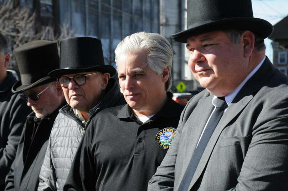 Left to right, Hartford Mayor Jim Hickerson, Godfrey Mayor Mike McCormick, Alton Mayor Brant Walker and Bethalto Mayor Alan Winslow stand by Sunday outside the Alton Visitor Center for Groundhog Day festivities. The mayors sport top hats in the tradition of Punxsutawney, Pennsylvania's elected officials when its famous groundhog, Phil, predicts the length of winter in its 134-year celebration. Photo: David Blanchette|For The Telegraph
