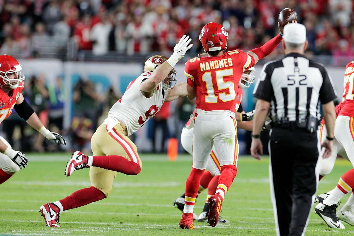 San Francisco 49ers' Nick Bosa goes after Kansas City Chiefs' Patrick Mahomes in the first quarter during Super Bowl LIV between the San Francisco 49ers and the Kansas City Chiefs at Hard Rock Stadium on Sunday, Feb. 2, 2020 in Miami Gardens, Fla.