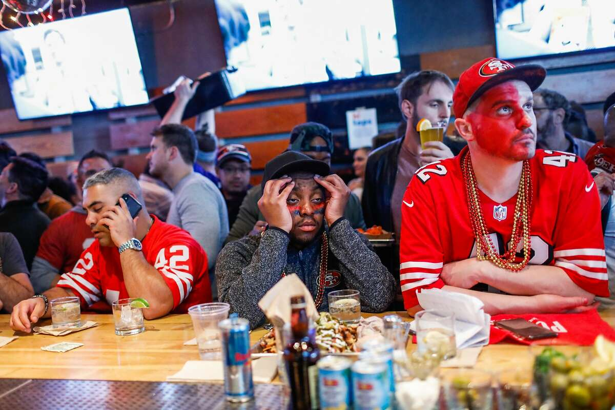 (L-r) 49ers fans Raul Rodriguez, Lou Johnson and Gary Heimeyer react to a bad play during the first half of the Super Bowl between the San Francisco 49ers and the Kansas City Chiefs at Hi Tops bar on Sunday, Feb. 2, 2020 in San Francisco, California.