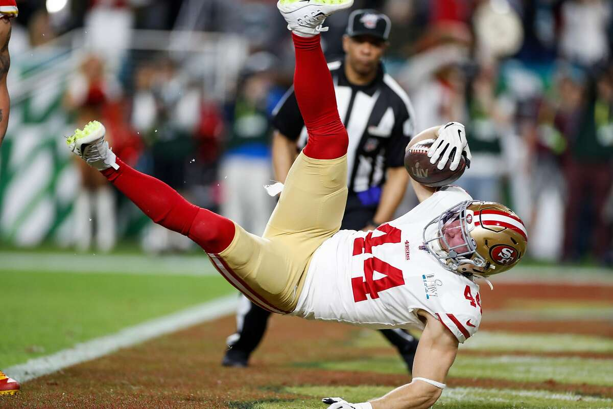 San Francisco 49ers' Kyle Juszczyk jumps over the goal line in the second quarter during Super Bowl LIV between the San Francisco 49ers and the Kansas City Chiefs at Hard Rock Stadium on Sunday, Feb. 2, 2020 in Miami Gardens, Fla.