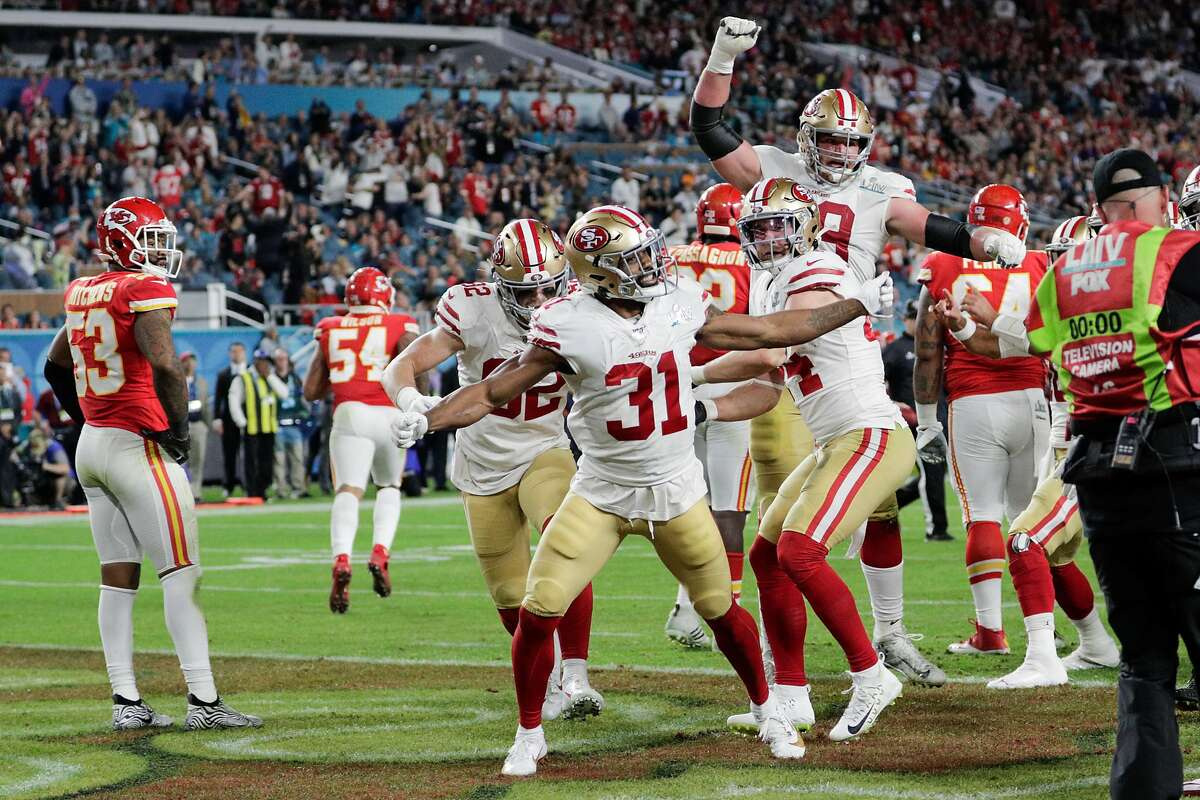 San Francisco 49ers' Raheem Mostert reacts after scoring in the third quarter during Super Bowl LIV between the San Francisco 49ers and the Kansas City Chiefs at Hard Rock Stadium on Sunday, Feb. 2, 2020 in Miami Gardens, Fla.