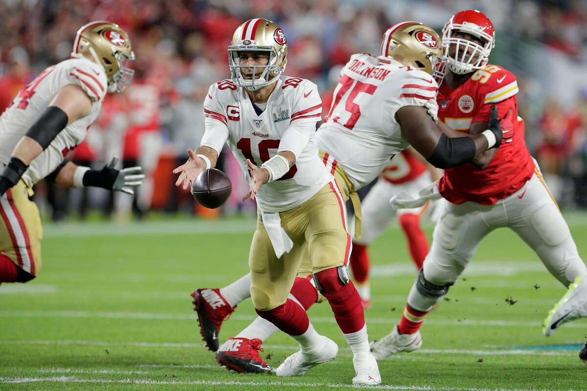 San Francisco 49ers' Jimmy Garoppolo tosses the ball to Tevin Coleman in the first quarter during Super Bowl LIV between the San Francisco 49ers and the Kansas City Chiefs at Hard Rock Stadium on Sunday, Feb. 2, 2020 in Miami Gardens, Fla.