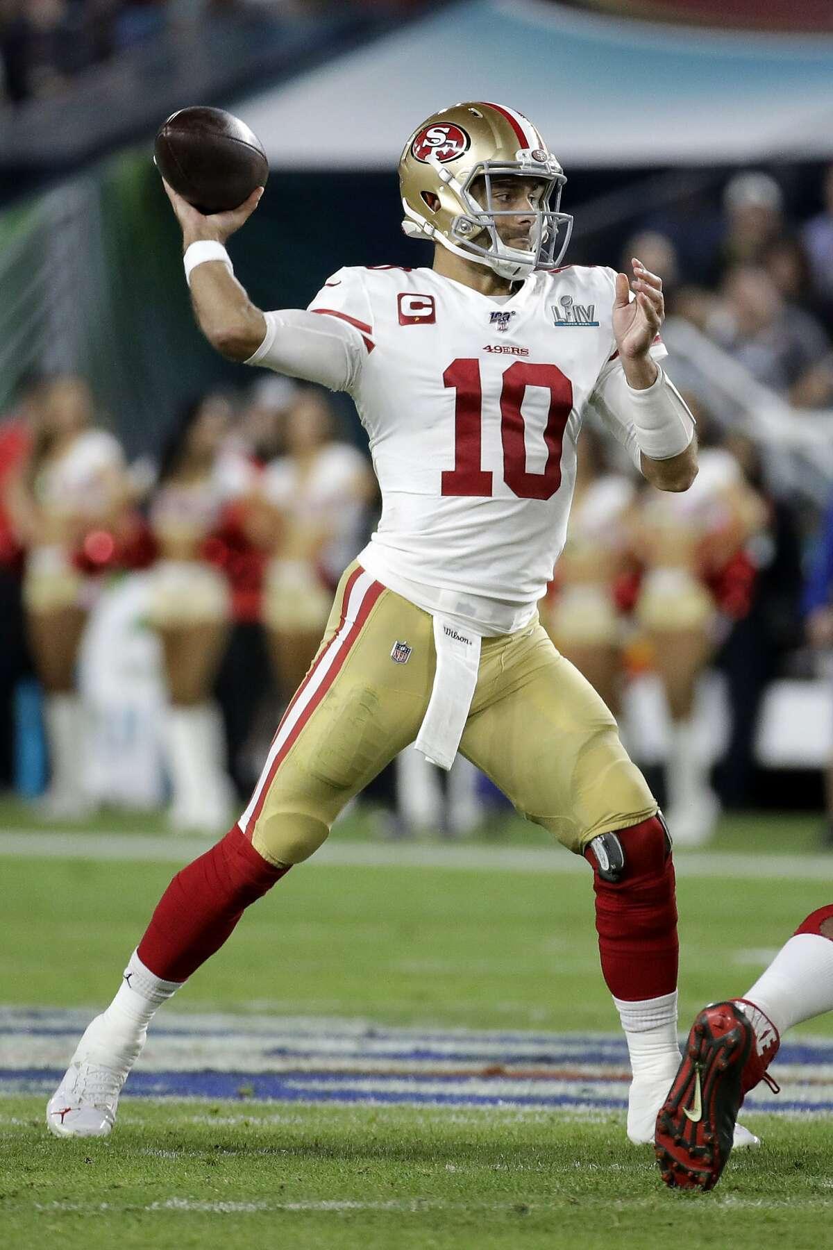 San Francisco 49ers quarterback Jimmy Garoppolo (10) works against the Kansas City Chiefs during the second half of the NFL Super Bowl 54 football game Sunday, Feb. 2, 2020, in Miami Gardens, Fla. (AP Photo/Patrick Semansky)