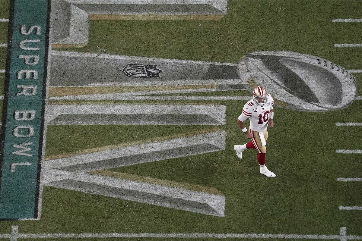 San Francisco 49ers quarterback Jimmy Garoppolo (10) walks on the field, during the second half of the NFL Super Bowl 54 football game against the Kansas City Chiefs', Sunday, Feb. 2, 2020, in Miami Gardens, Fla. (AP Photo/Morry Gash)