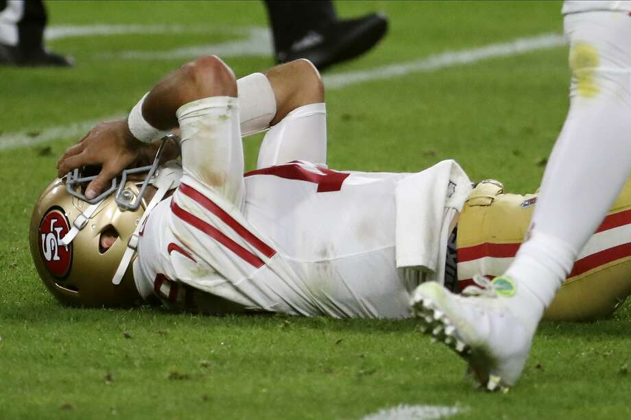 San Francisco 49ers quarterback Jimmy Garoppolo lays on the ground after being hit during the second half of the NFL Super Bowl 54 football game against the Kansas City Chiefs Sunday, Feb. 2, 2020, in Miami Gardens, Fla. (AP Photo/Matt York) Photo: Matt York / Associated Press