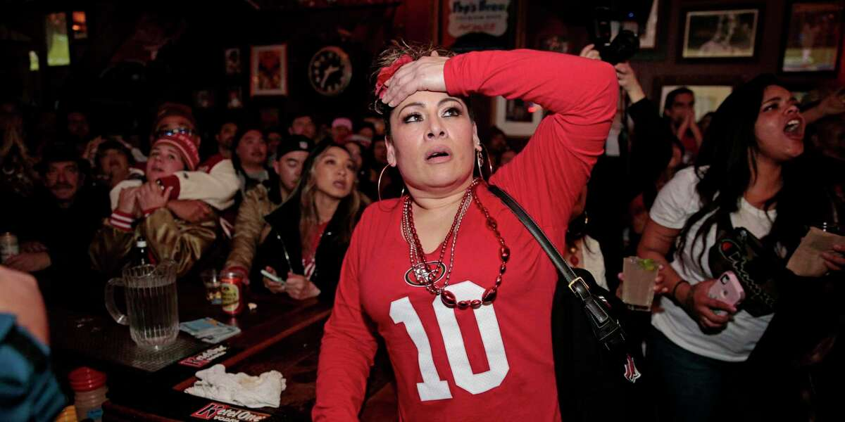 Yesenia Aviles reacts as the San Francisco 49ers lose possession in the final couple minutes against the Kansas City Chiefs during the Super Bowl LIV game on the screens at Pop's Bar, Sunday, Feb. 2, 2020, in San Francisco, Calif. The Chiefs scores a touchdown on the next play.