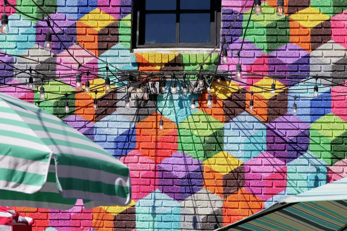 The wall mural of colored squares on the exterior walls of Present Company in Montrose. A Dallas muralist claims the mural on the side of club is a copy of his.