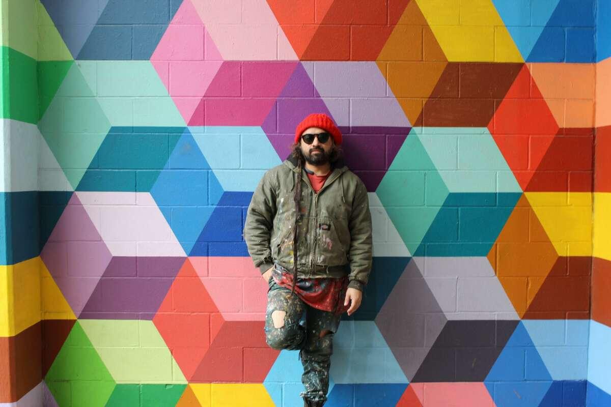 Dallas artist Ricardo Paniagua in front of his mural