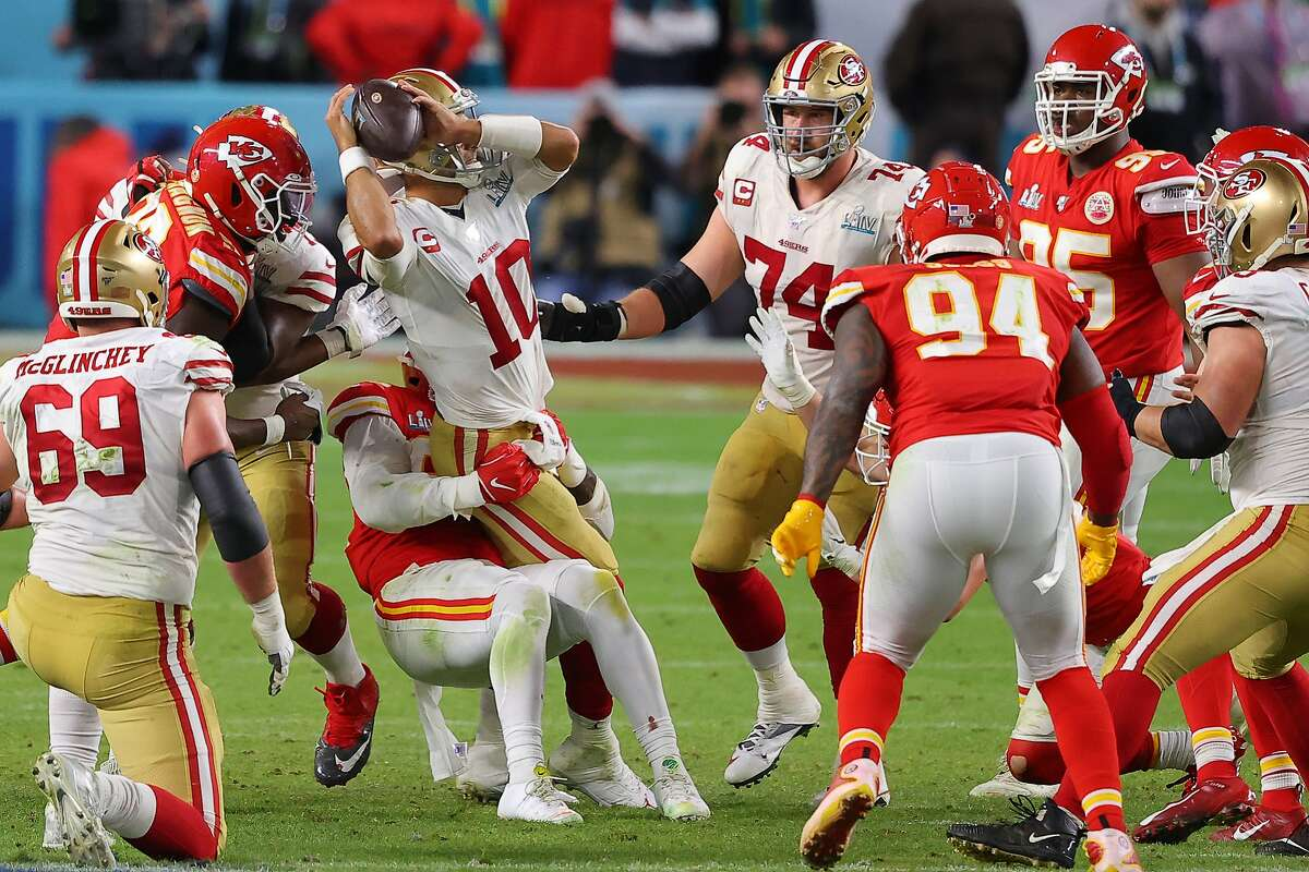 Jimmy Garoppolo #10 of the San Francisco 49ers is sacked by Frank Clark #55 of the Kansas City Chiefs during the fourth quarter in Super Bowl LIV at Hard Rock Stadium on February 02, 2020 in Miami, Florida. (Photo by Ronald Martinez/Getty Images)