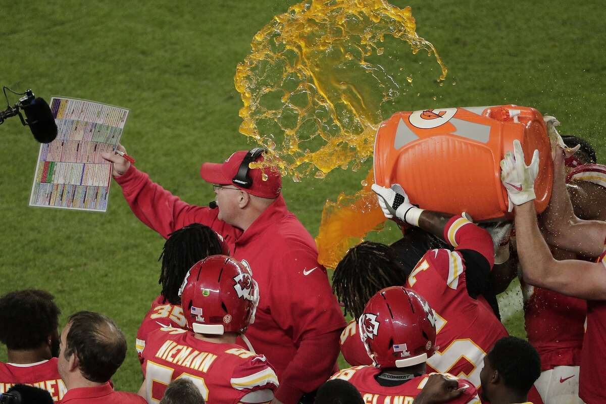 Kansas City Chiefs players pour a cooler of Gatorade on head coach Andy Reid during the second half of the NFL Super Bowl LIV football game against the San Francisco 49ers, Sunday, Feb. 2, 2020, in Miami Gardens, Fla. The Chiefs defeated the 49ers 31-20.