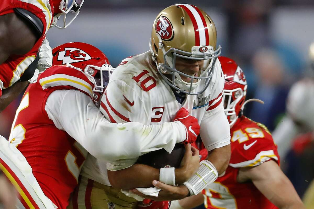 MIAMI, FLORIDA - FEBRUARY 02: Jimmy Garoppolo #10 of the San Francisco 49ers rushes the ball against Kansas City Chiefs defense in Super Bowl LIV at Hard Rock Stadium on February 02, 2020 in Miami, Florida. (Photo by Kevin C. Cox/Getty Images)