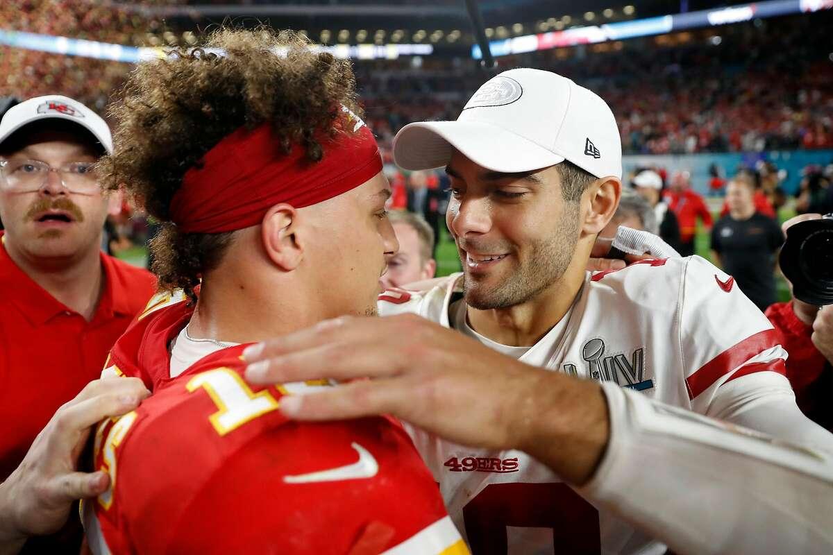 San Francisco 49ers' Jimmy Garoppolo greets Kansas City Chiefs' Patrick Mahomes after Chiefs' 31-20 win in Super Bowl LIV at Hard Rock Stadium in Miami Gardens, Florida, on Sunday, February 2, 2020.