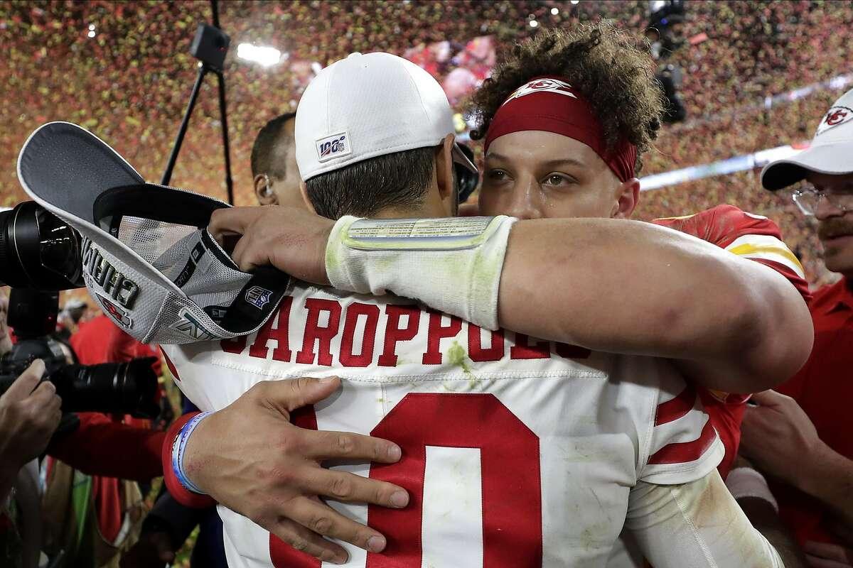 Kansas City Chiefs' quarterback Patrick Mahomes, rear, embraces San Francisco 49ers' quarterback Jimmy Garoppolo after winning the NFL Super Bowl 54 football game Sunday, Feb. 2, 2020, in Miami Gardens, Fla. (AP Photo/Matt York)
