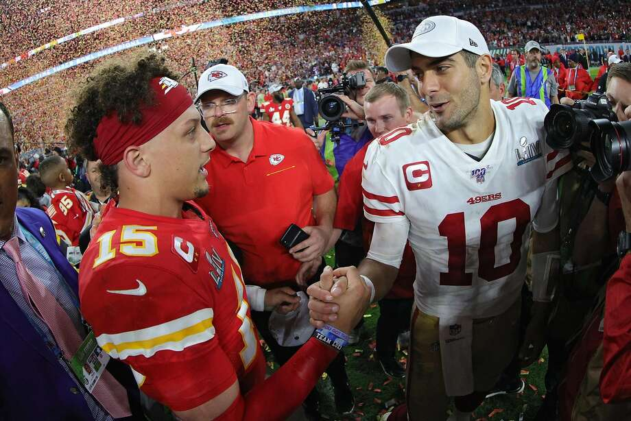 Patrick Mahomes of the Kansas City Chiefs shakes hands with Jimmy Garoppolo of the San Francisco 49ers after Super Bowl LIV at Hard Rock Stadium on February 2, 2020 in Miami. Photo: Tom Pennington / Getty Images