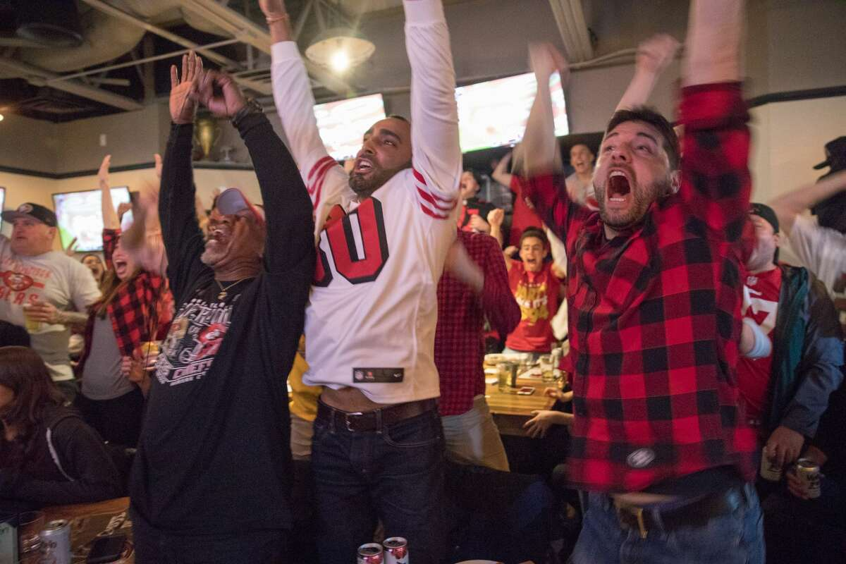 49ers fans celebrate the team's first touchdown in Super Bowl 54 while watching the game at the San Francisco Athletic Club in San Francisco on Feb 2, 2020.
