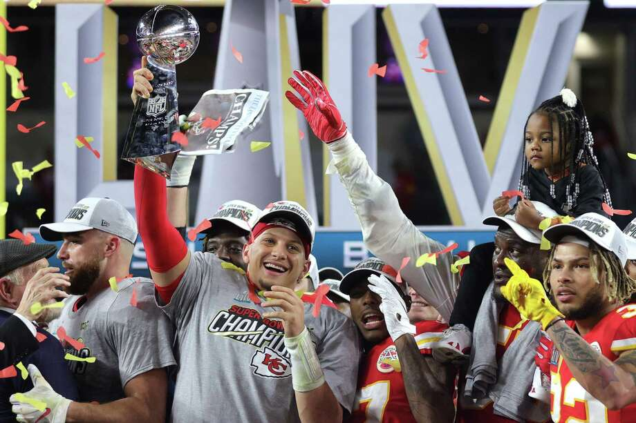 Patrick Mahomes #15 of the Kansas City Chiefs raises the Vince Lombardi Trophy after defeating the San Francisco 49ers 31-20 in Super Bowl LIV at Hard Rock Stadium on February 02, 2020 in Miami, Florida. Photo: Jamie Squire, Staff / Getty Images / 2020 Getty Images