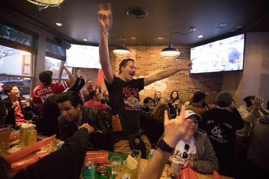 49ers fan Goakim Angstrom celebrates a 49ers interception while watching Super Bowl 54 at Hi Tops sports bar in San Francisco on Feb 2, 2020. Photo: Douglas Zimmerman/SFGate.com