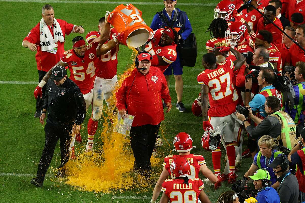 MIAMI, FLORIDA - FEBRUARY 02: Head coach Andy Reid of the Kansas City Chiefs gets a ice bath after defeating the San Francisco 49ers 31-20 in Super Bowl LIV at Hard Rock Stadium on February 02, 2020 in Miami, Florida. (Photo by Mike Ehrmann/Getty Images)