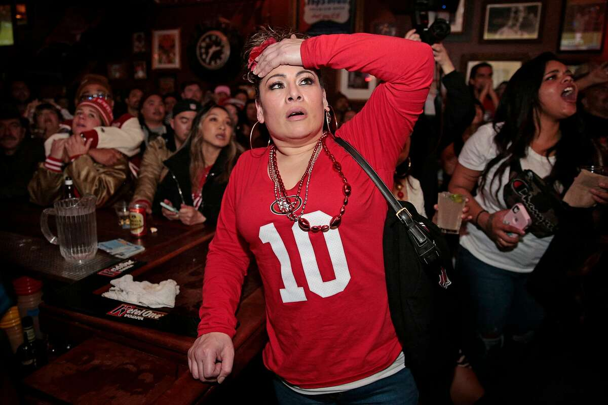 Yesenia Aviles reacts as the San Francisco 49ers lose possession in the final couple minutes against the Kansas City Chiefs during the Super Bowl LIV game on the screens at Pop�s Bar, Sunday, Feb. 2, 2020, in San Francisco, Calif. The Chiefs scores a touchdown on the next play.