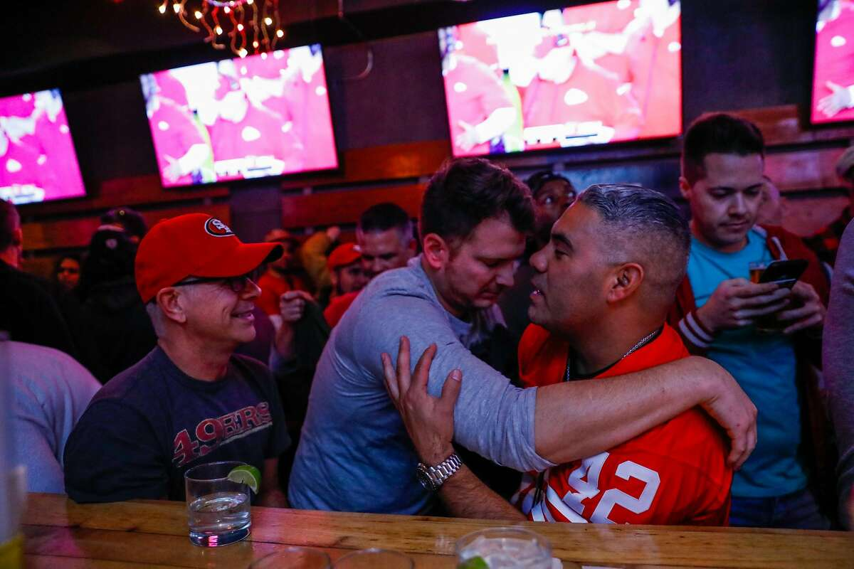 49ers fan Gary Seierh (center) hugs Raul Rodriguez after the 49ers lost the Super Bowl at Hi Tops bar on Sunday, Feb. 2, 2020 in San Francisco, California.The Kansas City Chiefs defeated the San Francisco 49ers 30-21.